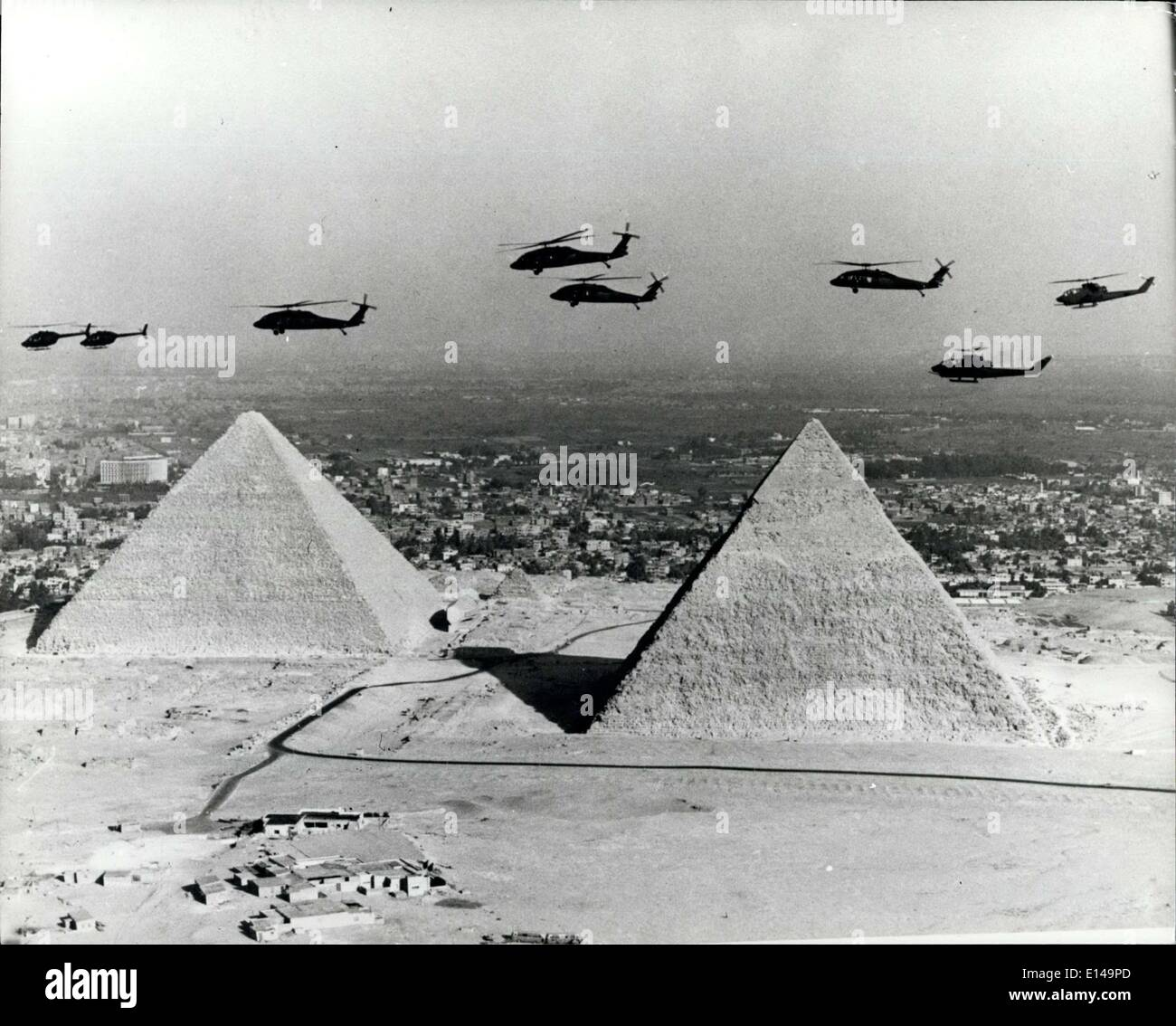 Apr. 17, 2012 - Contrast in Civilisations: This extraordinary spectacle marks a striking contrast in the civilisations of our planet. Hovering over the pyramids of El Giza, Cairo, is seen a flight of 20th century helicopters, symbols of man's technological advance. Beneath lies the history of the ancient Egyptians enshrined in monuments some 5000 years past. - Stock Image