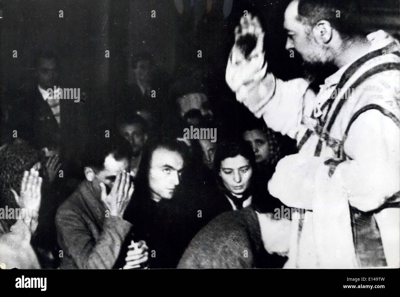 Apr. 17, 2012 - Picture Shows:- Padre Pio as he blesses the faithful in the church of the Capuchin convent. The stigma on his right hand is clearly visible. - Stock Image