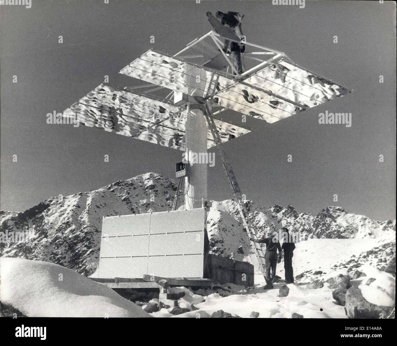 Apr. 17, 2012 - Mirroring the sun: Workers fix mirror elements to a heliostat located  mountain Eastern Switzerland. - Stock Image