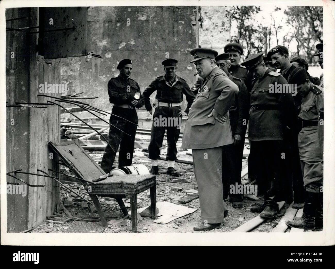 Apr. 17, 2012 - Churchill sees smashed Hitler's chair: During his tour of the Ruined Chancellery Mr. Churchill was shown by his - Stock Image