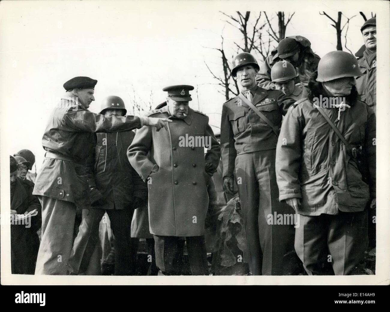 Apr. 17, 2012 - Mr. Churchill in Germany visit to 9th Army Front : The Prime Minister paid a visit to the Siegfried Line and saw the famous Citadel of Julich. Picture shows ''Monty'' points out where the flame - throwers were in action. Next to him is Mr. Churchill, Gen. Simpson, C-in-C. U.S. 9th Army and Gen Gilla, Picture taken outside the Citadel in Julich. - Stock Image