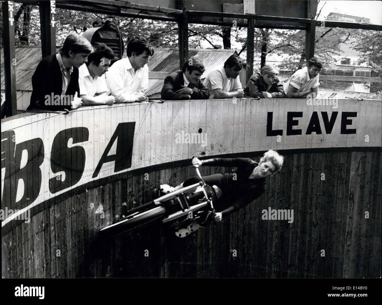 Apr. 17, 2012 - What's driven her up the wall? the sheer joy of roaring round the 20' Wall of Death. - Stock Image