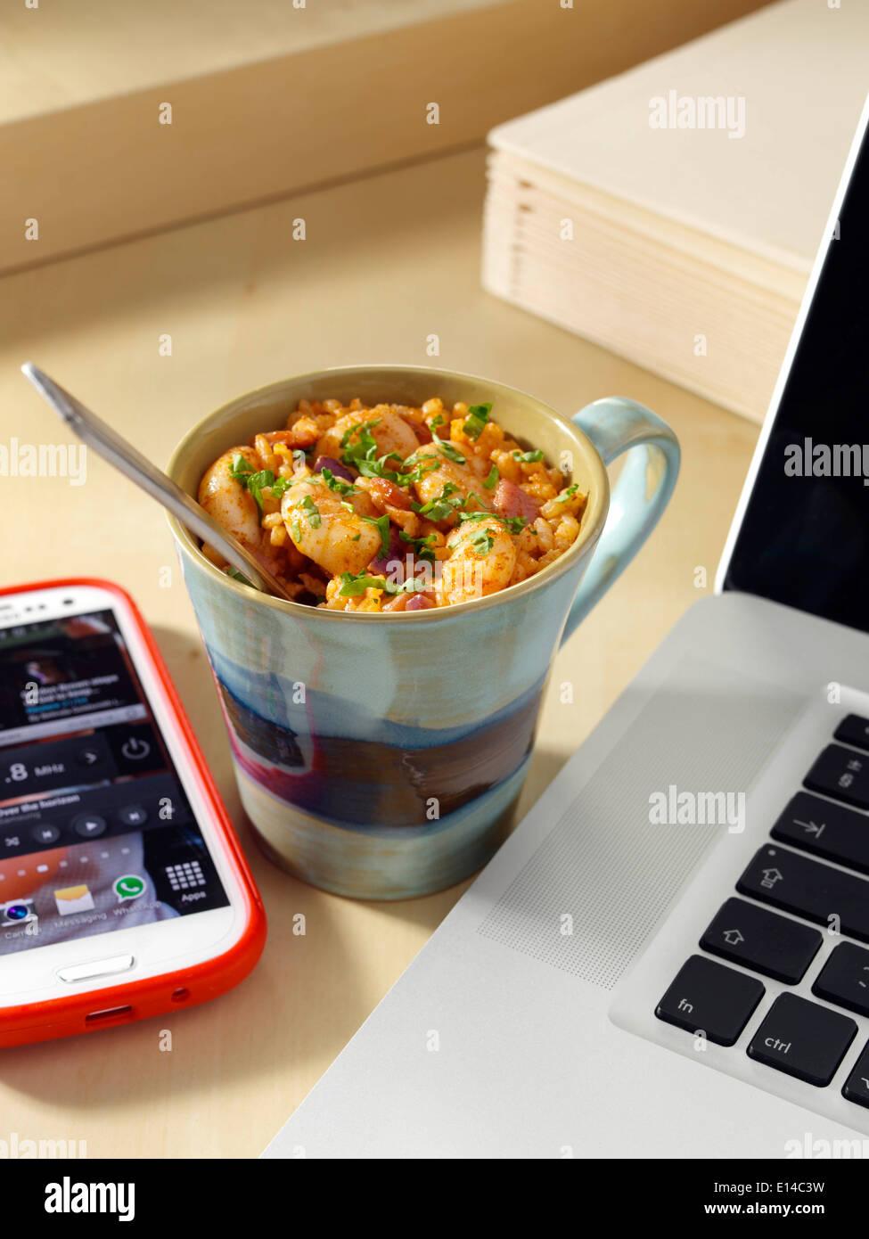 Prawn pilau microwaved in a mug - Stock Image