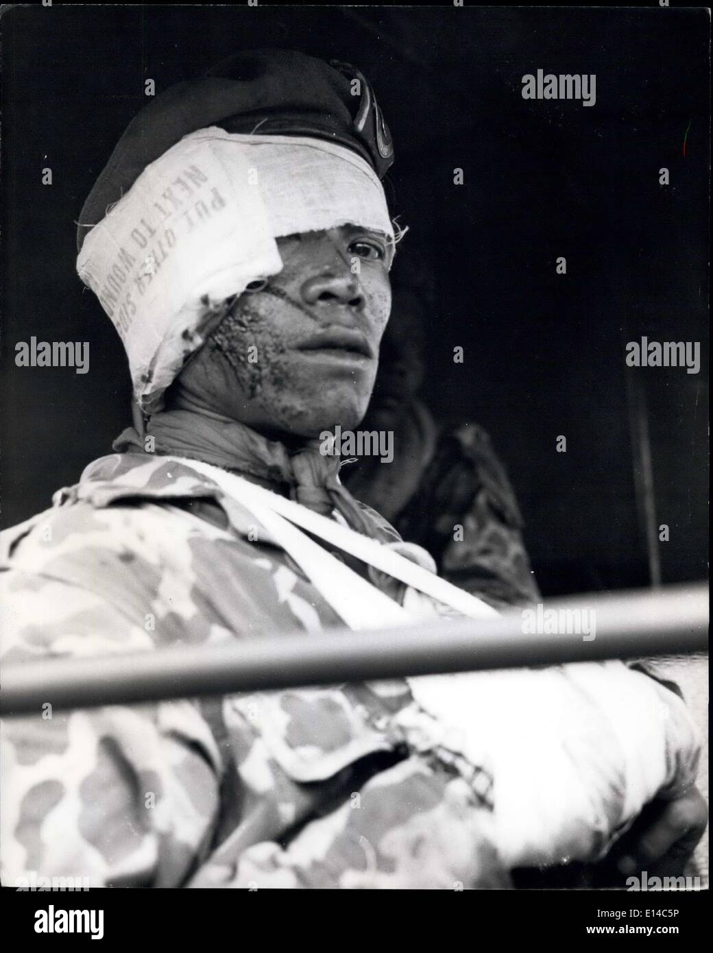 Apr. 17, 2012 - One of the Banteng Raiders, the Government's Commando Force, wounded during the first day's fighting en route from Bukit Tinggi to Suliki. On the first day give were wounded, and four died. Rebel losses are believed to be much greather. - Stock Image
