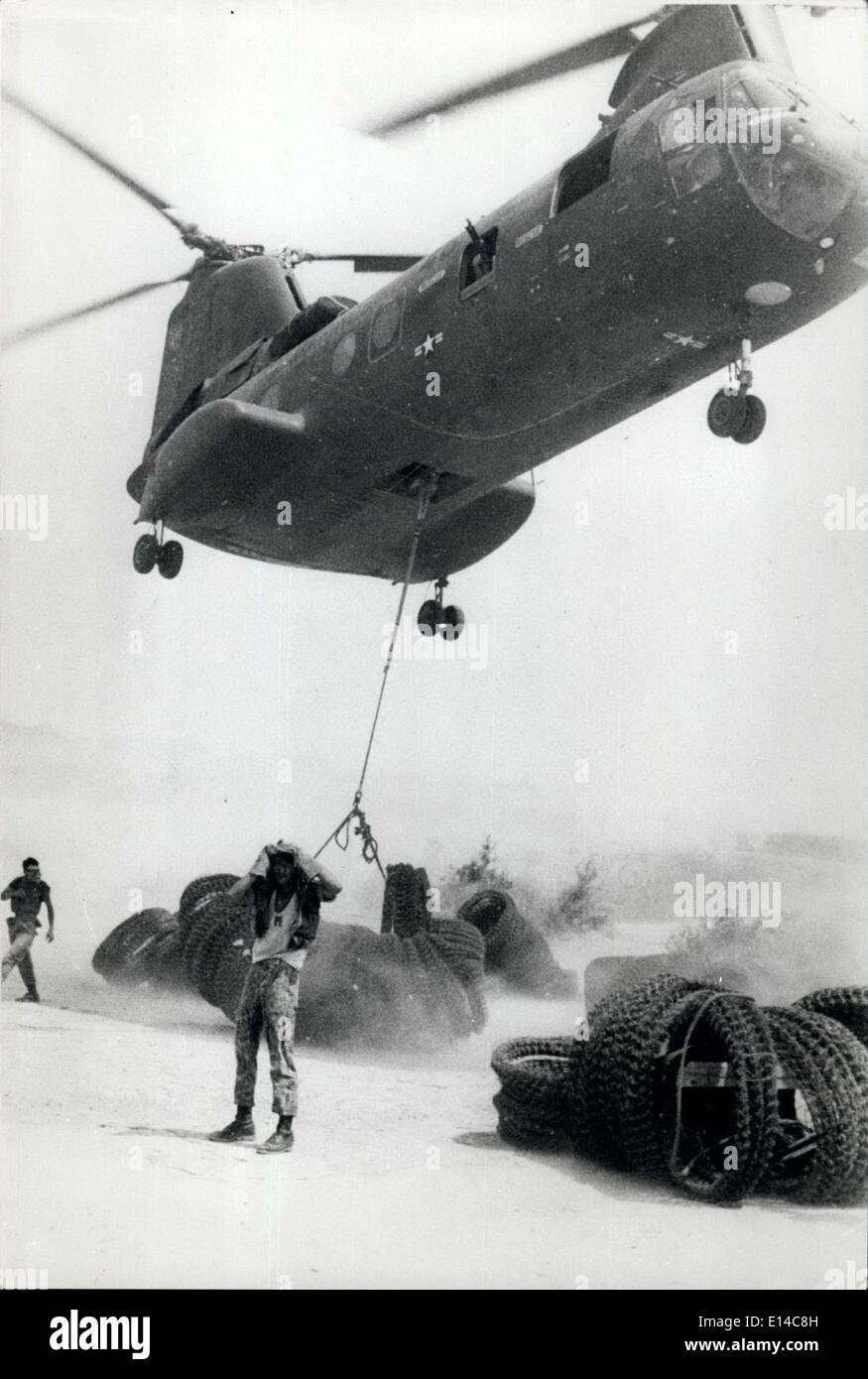 Apr. 17, 2012 - Vietnam war, barbed wire by air; A powerful Ch-46A helicopter churns up dust as it hovers to haul up coils of barbwire at Chu Lai to carry to Korean Marines who are fighting alongside US Marines at the front. - Stock Image