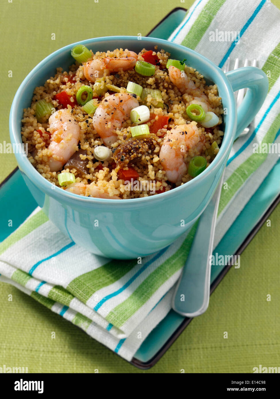 Prawns and couscous microwaved in a mug - Stock Image
