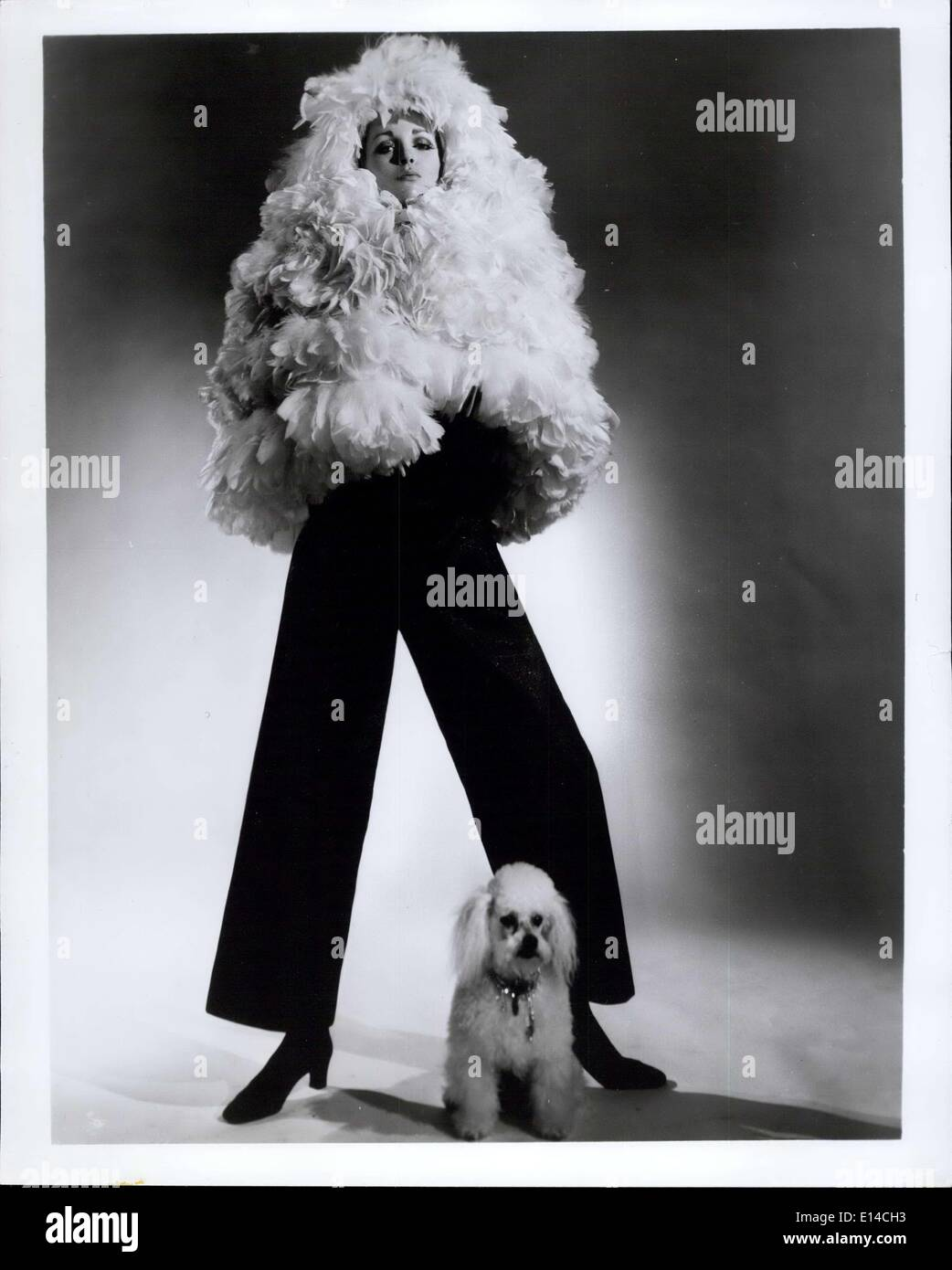 Apr. 17, 2012 - The grand entrance by Werle... The cape a fluff of Coq feathers topping the long sleeved-evening pants-all in one of luxurious strinque. Sizes 8 to 14. To retail about 95.00. - Stock Image