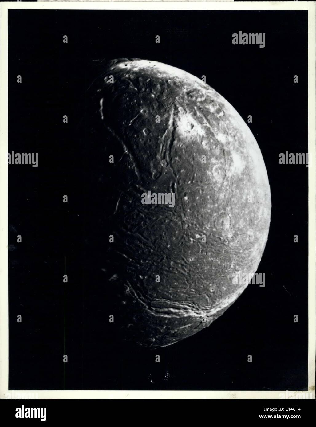 Apr. 17, 2012 - This mosaic of the four highest -resolution images of Ariel represents the most detailed Voyager 2 picture of this satellite of Uranus. The images were taken through the clear filter of Voyager's narrow -angle camera on Jan, 1986, at a distance of about 130,000 kilometers (80,000 miles). Ariel about 1,200 km (750 mi) in diameter, the resolution here is 2.4 km (1.5 mi). Much of Ariel;'s surface is densely pitted with craters 5 to 10 km (3 to 6 mi) across. These craters are close to the threshold of detection in this picture - Stock Image