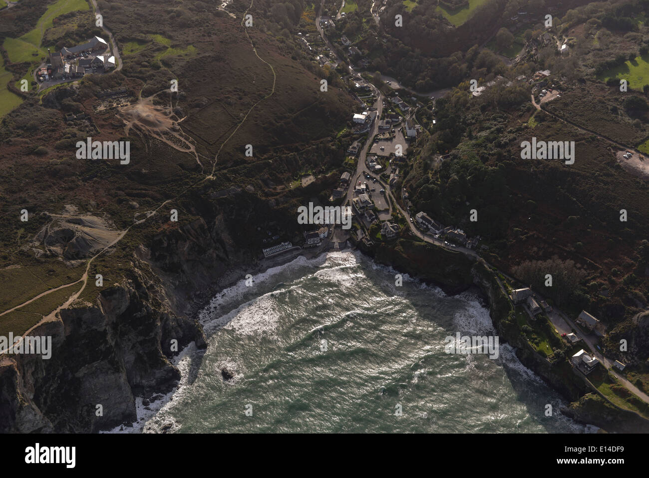 An atmospheric evening aerial view showing the coast of Cornwall looking inland toward St Agnes - Stock Image