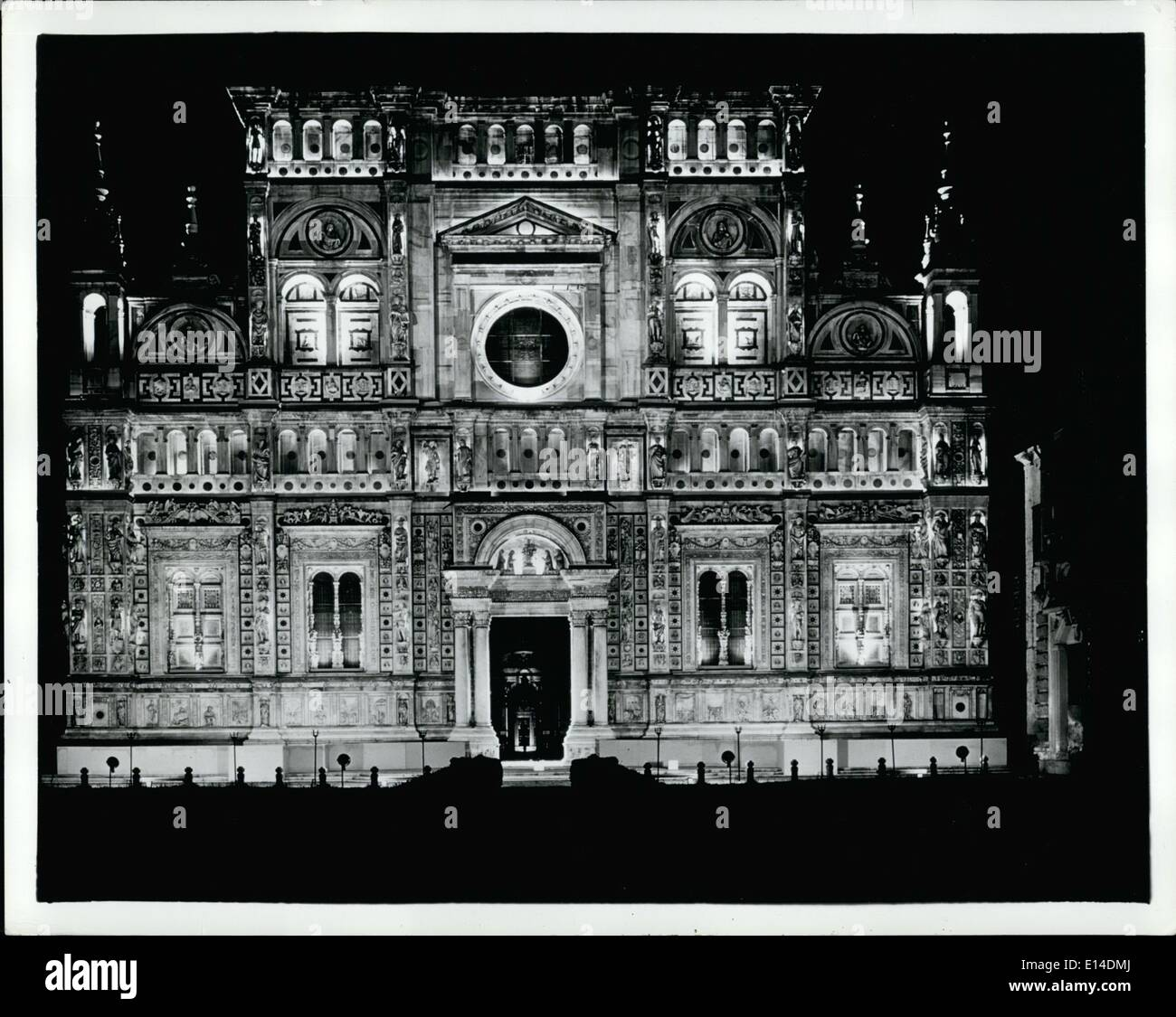 Apr. 18, 2012 - Carthusian monastery in Italy illuminated for first time in it's six century history: The Carthusian Monastery of Pavia has been illuminated for the first time in its 600 year history with carefully placed lamps individually highlighting the elaborate carvings which make the structure one of the finest examples of Renaiissance architecture in existence. Shown (above) is the facade of the charterhouse - Stock Image