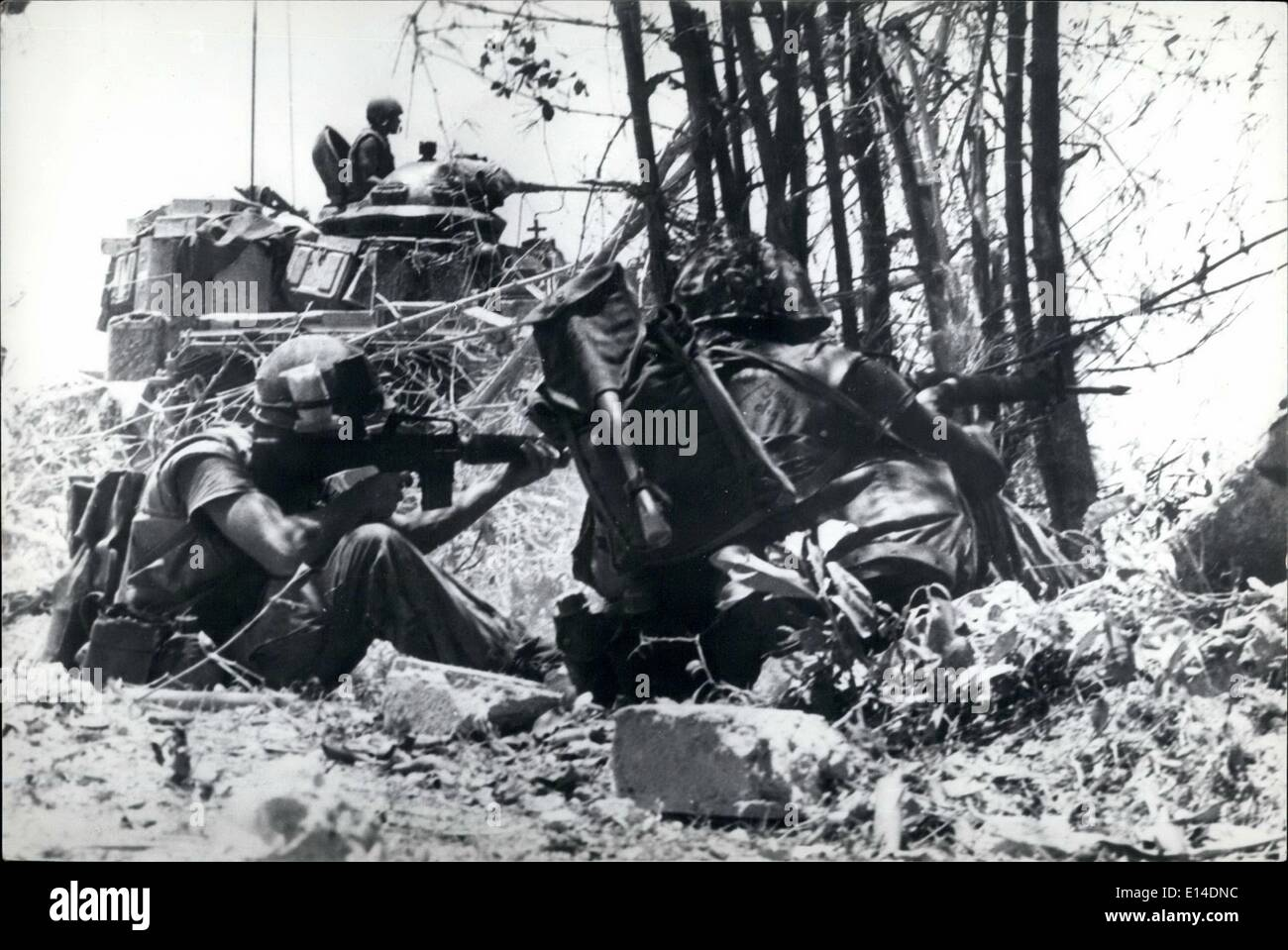 Apr. 18, 2012 - Help from big brother: A US tank gives supporting fire to marine riflemen trying to dislodge North Vietnamese troops well dug in north of Dong Ha. - Stock Image