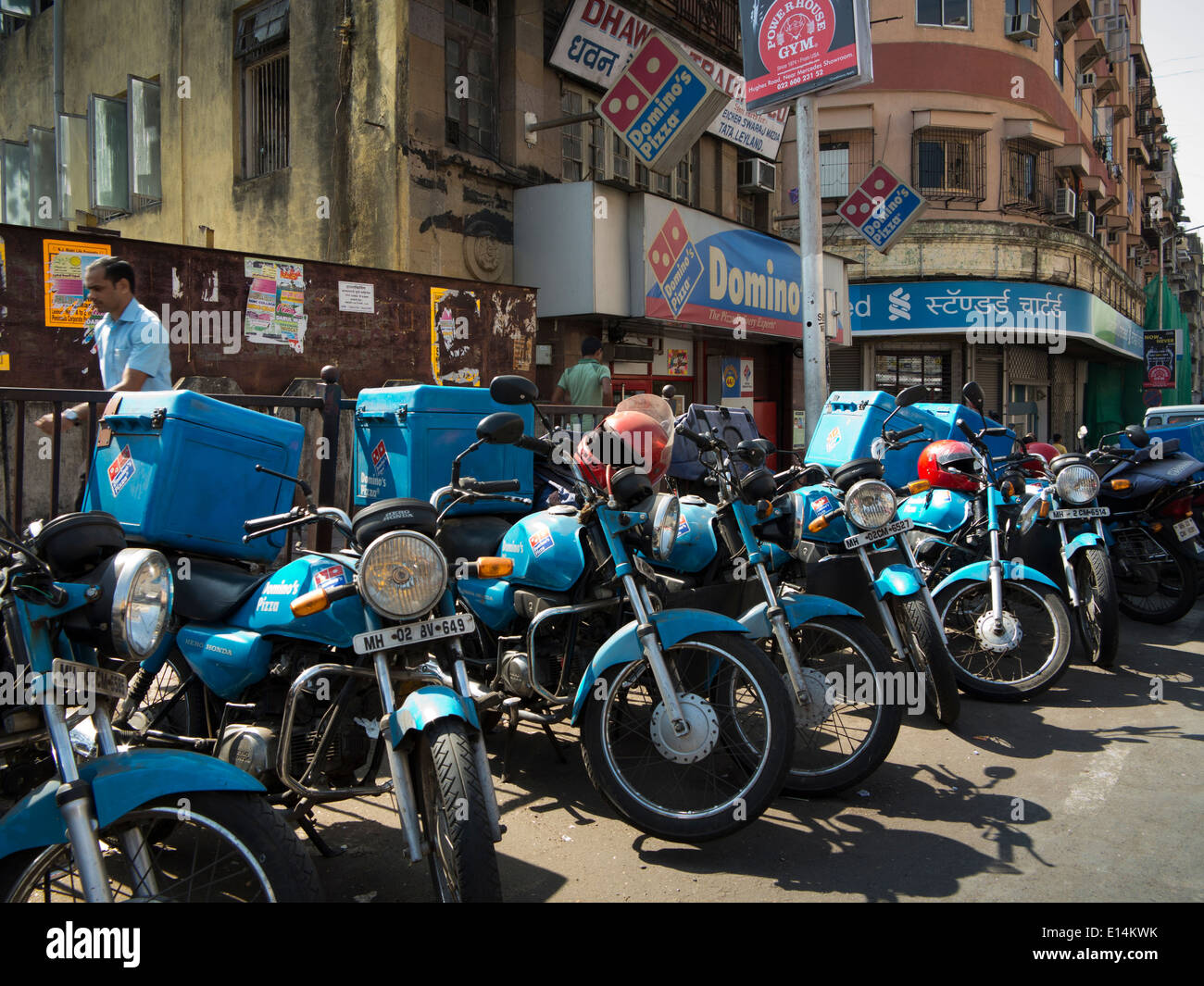 India, Mumbai, Fast Food, Dominos pizza delivery bikes parked on the road - Stock Image