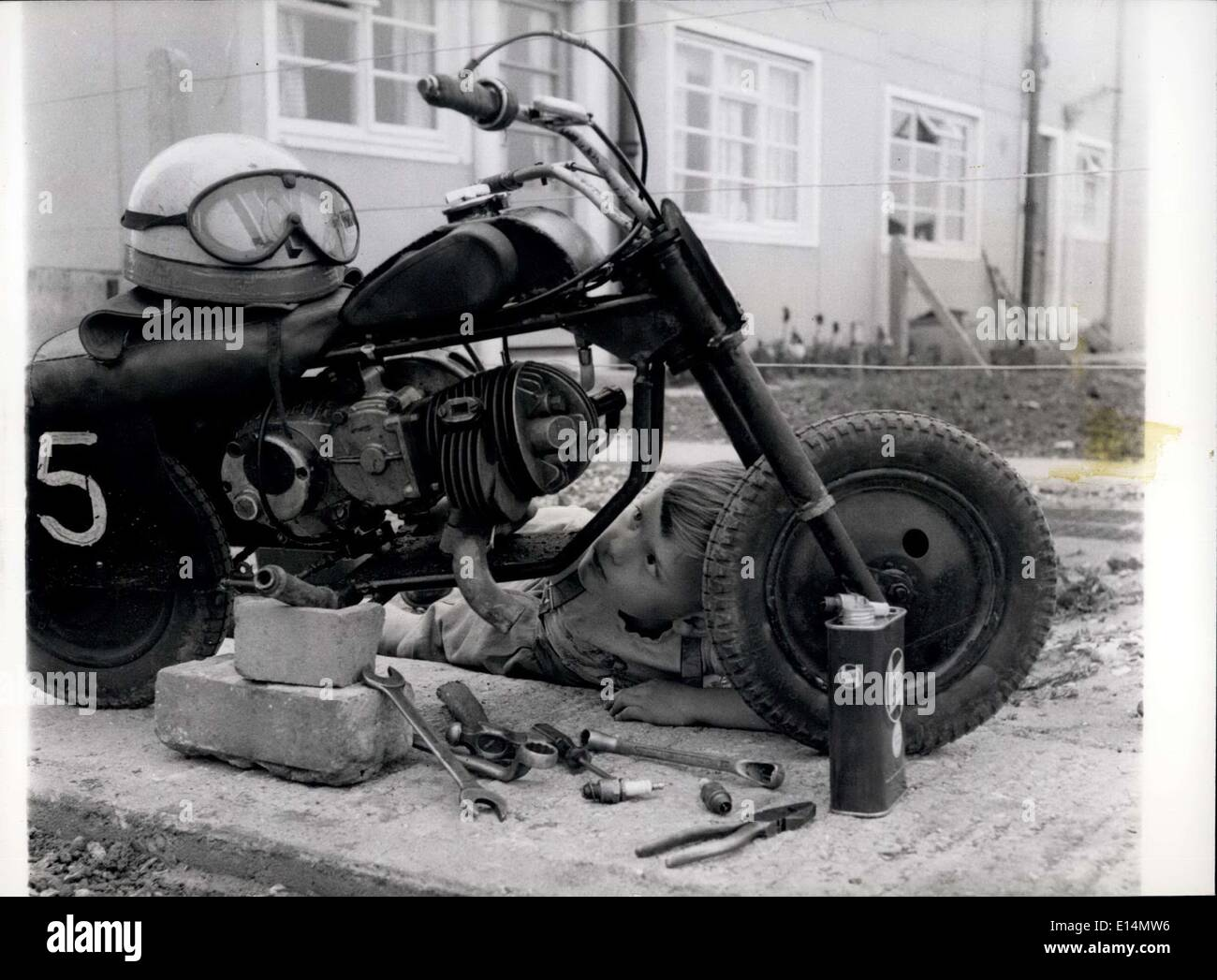 Apr. 05, 2012 - Motorbike Mechanic - At Six: C Clive Loynes gets down to a sot of work on his bike. He knows how it works, and - Stock Image