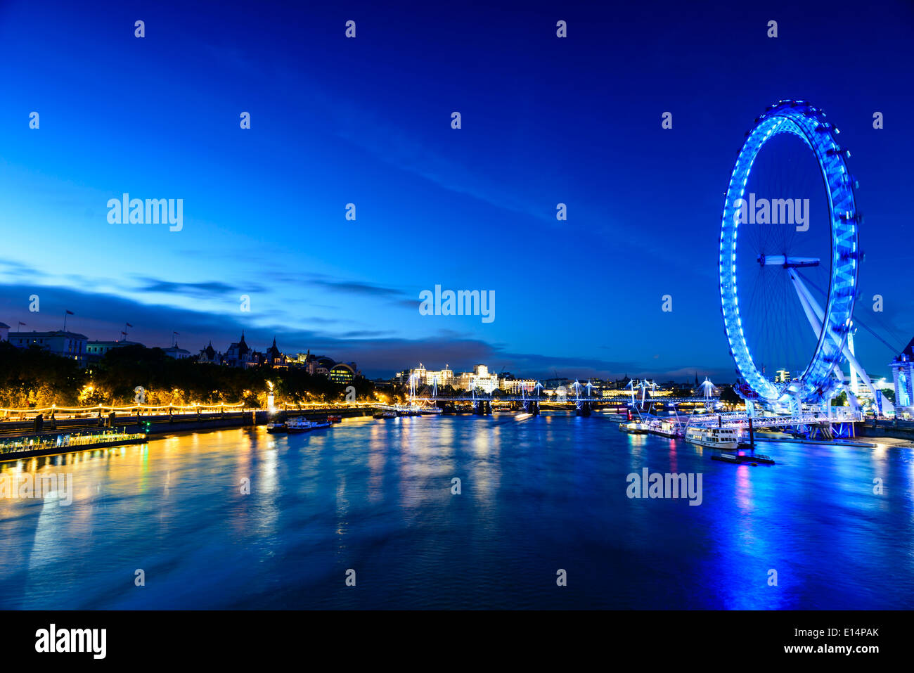 London Eye overlooking river front, London, United Kingdom - Stock Image