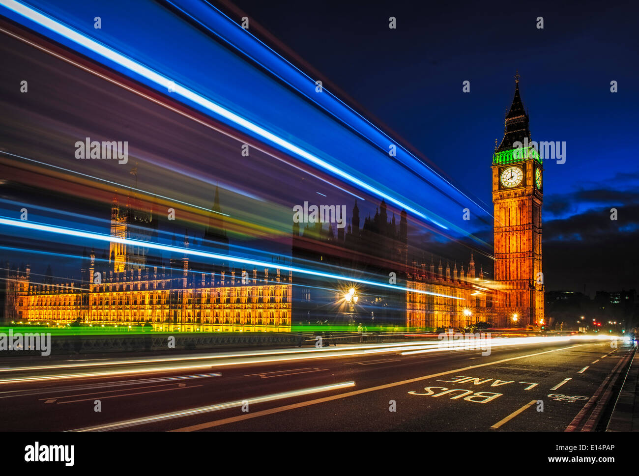 Long exposure view of traffic by Big Ben, London, United Kingdom - Stock Image