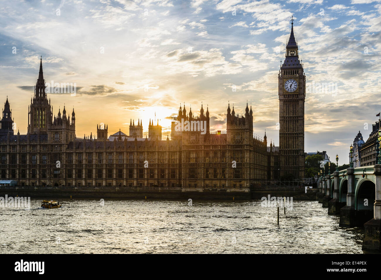 Sun setting over Houses of Parliament, London, United Kingdom - Stock Image