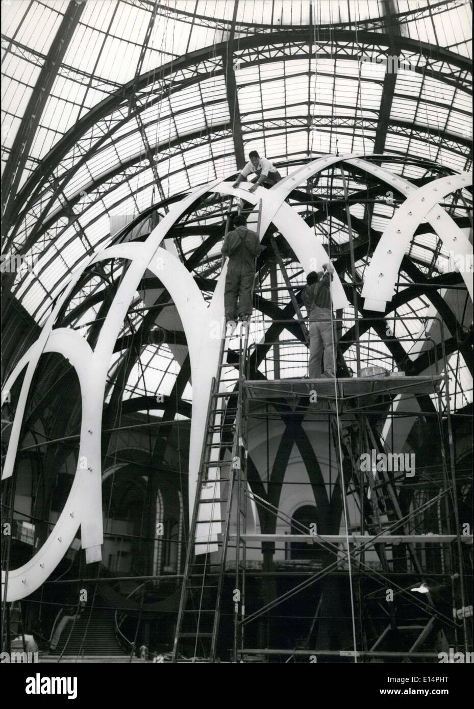Apr. 12, 2012 - AUTOMOBILE SHOW PREPARATION: AS EVERY YEAR, AT THE PARIS GRAND PALAIS, WILL BE HELD THE AUTOMOBILE SHOW WHERE WE HOPE TO SEE THE NEW MODELS WHICH WILL HE SHOWN TO THE PUBLIC. NPM: WORKMEN PREPARING A NEW ILLUMINATION PUT ON AN ENORMOUS GLOBE. - Stock Image
