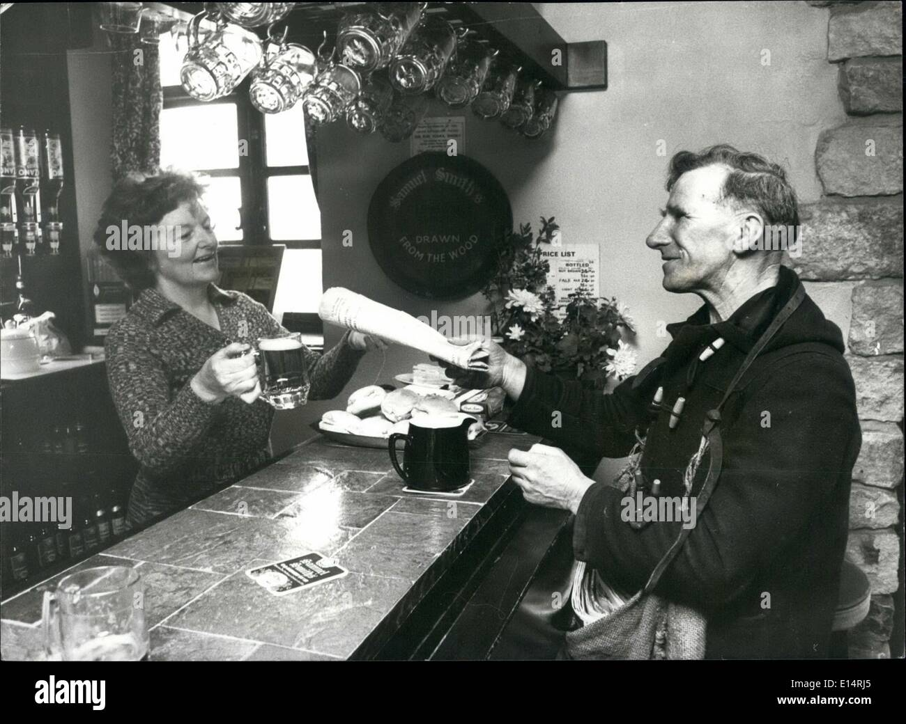Apr. 18, 2012 - Alan stops in at his favourite pub and exchanges the paper for a pint, with landlady Connie Braithwaite, of the - Stock Image
