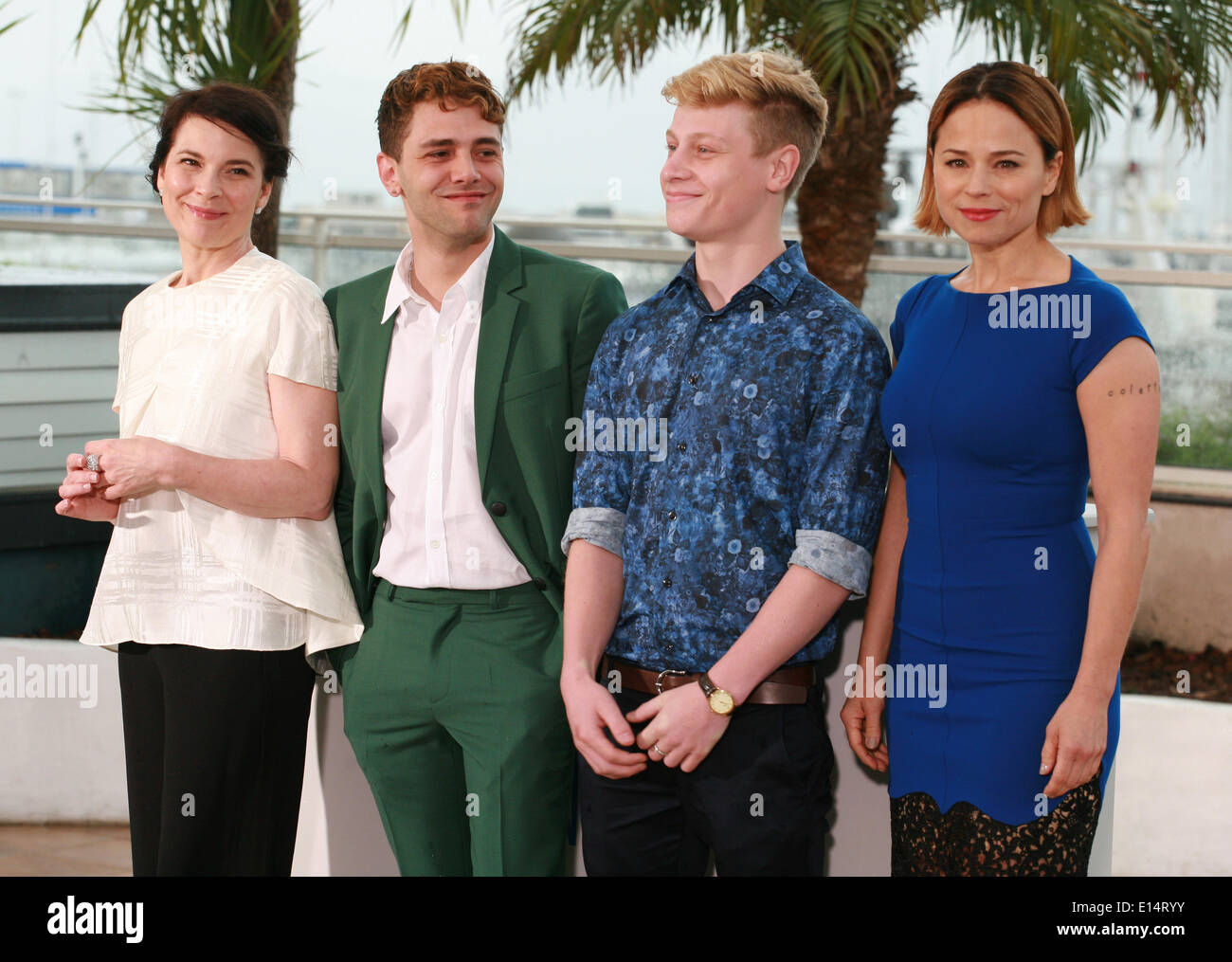 Cannes, France. 22nd May, 2014. Anne Dorval, Director Xavier Dolan, Antoine-Olivier Pilon and Suzanne Clément at the photo call for the film Mommy at the 67th Cannes Film Festival, Thursday 22nd May 2014, Cannes, France. Credit:  Doreen Kennedy/Alamy Live News - Stock Image