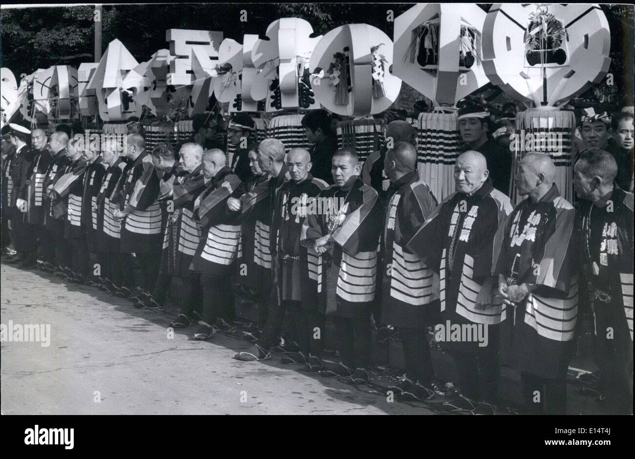 Apr. 18, 2012 - Some of the survivors of the old Tokyo volunteer fire fighters stand beneath their district insignas, - Stock Image