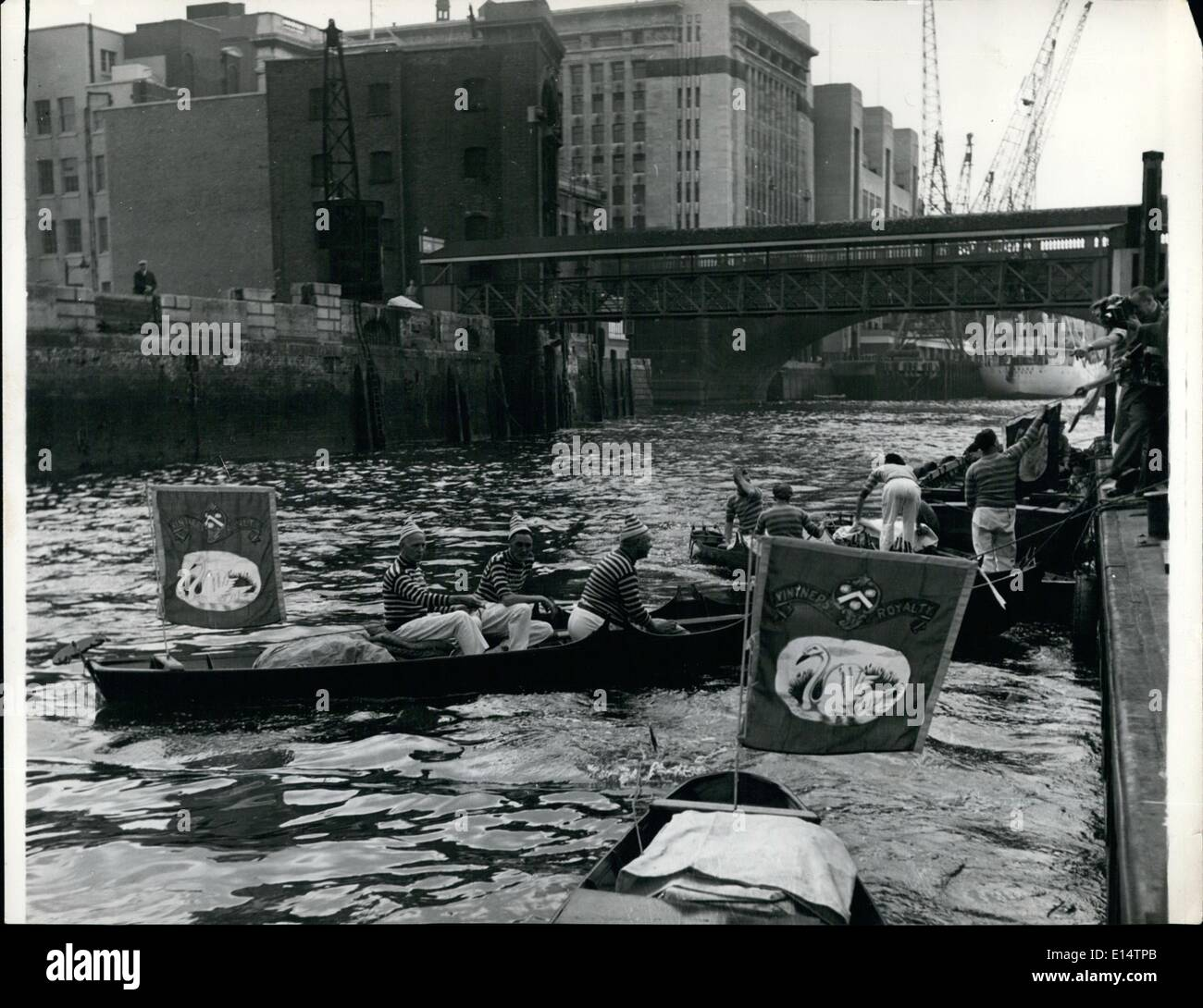 Apr. 18, 2012 - SWAN UPPING: The busy scene at Old Swan Pier, London Bridge as Swan Uppers is boats flying the pennants of the Vintners and Dyers Company prepare for the annual ceremony of marking the new cygnets. - Stock Image