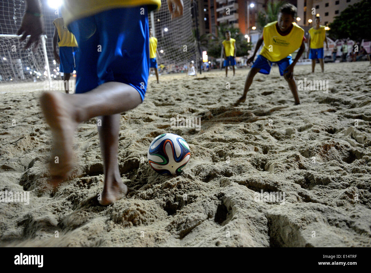 Young people playing football in the evening at the beach, Praia de Iracema, Fortaleza, Ceará, Brazil Stock Photo
