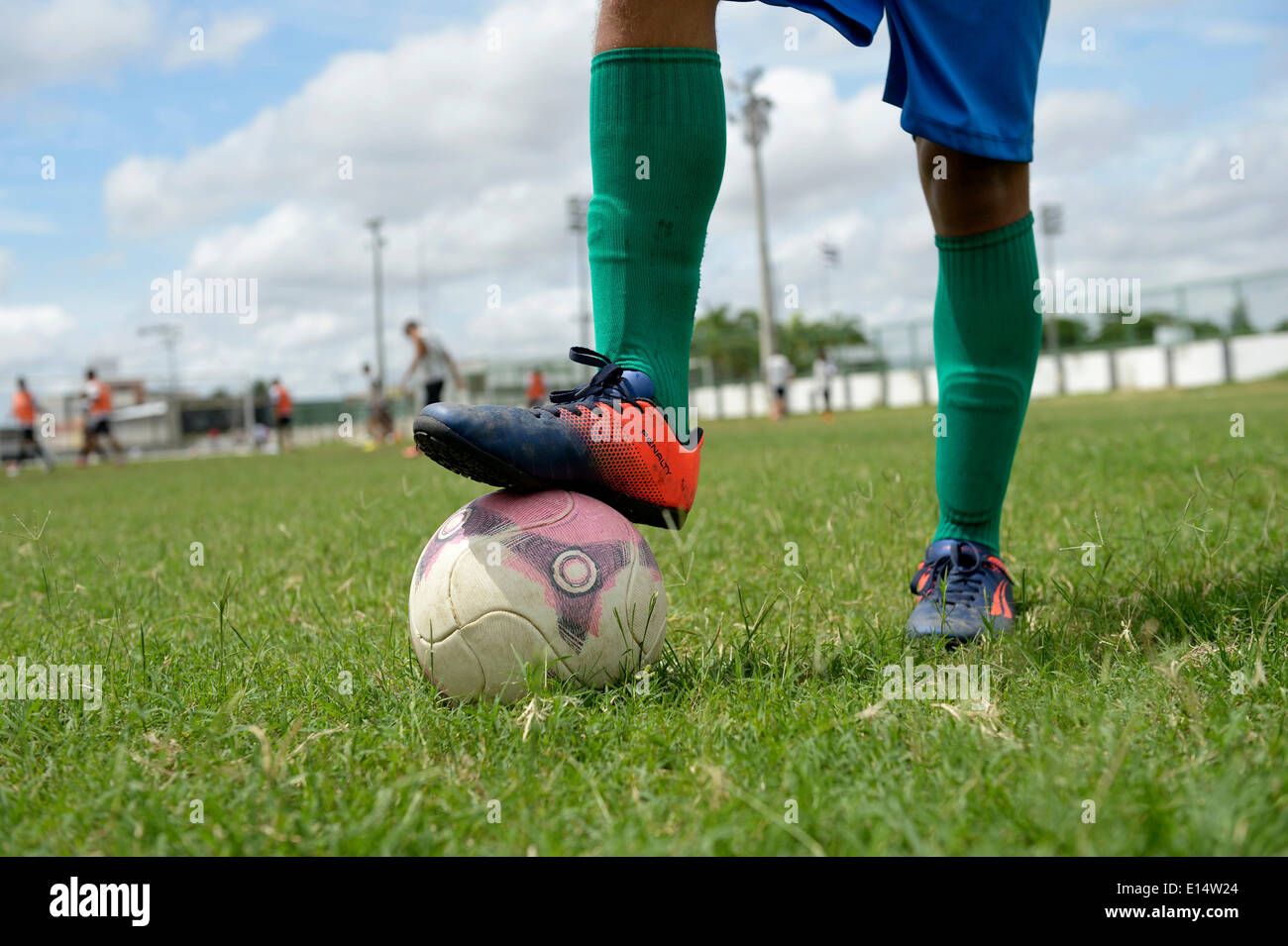 Soccer, kick off, boy holding a ball still with his foot, Fortaleza, Ceará, Brazil - Stock Image