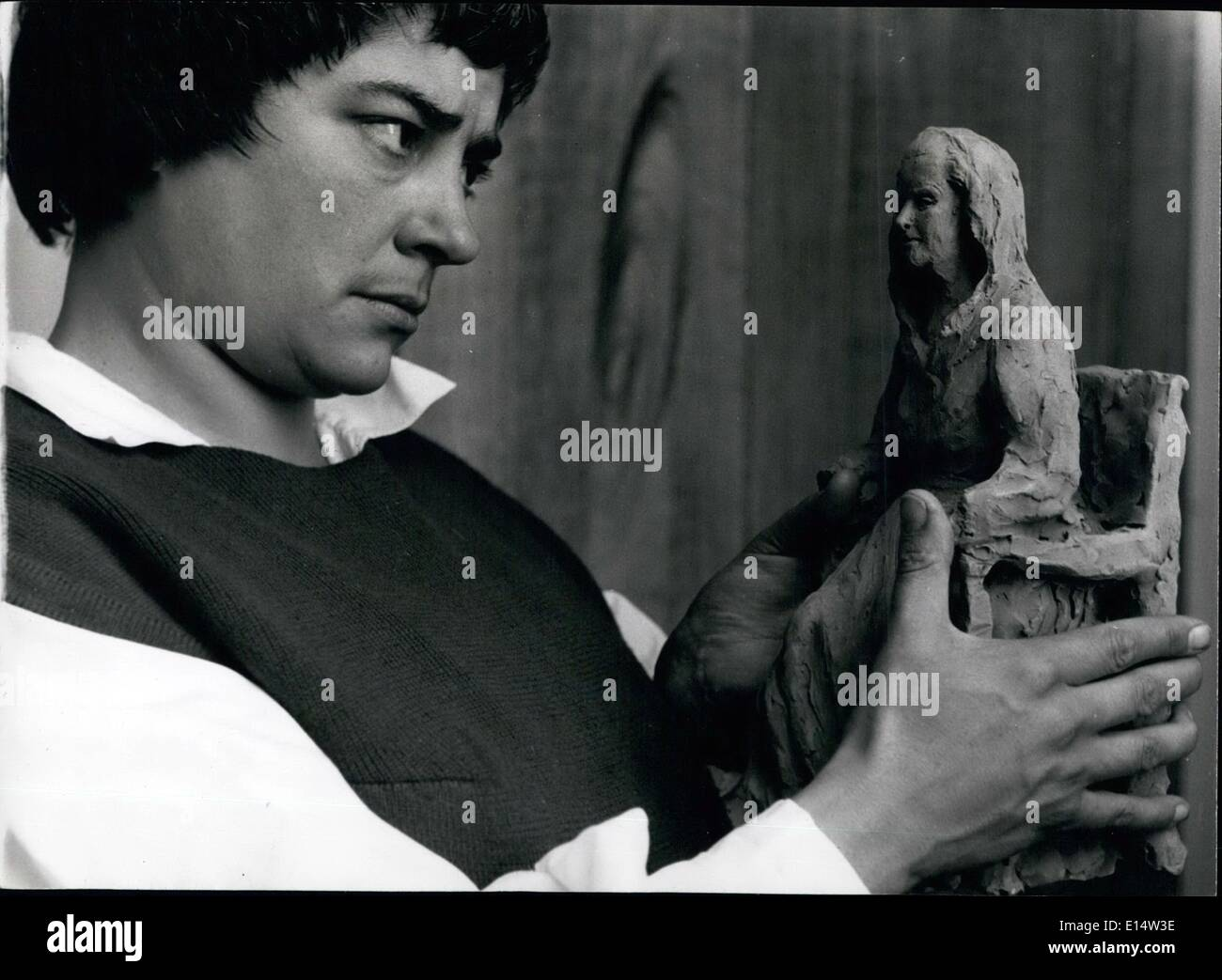 Apr. 18, 2012 - Creator and Creation : Miss Henriquez looks Quizzically at her sculpture of Mrs. Augustus John, wife of the artist. - Stock Image