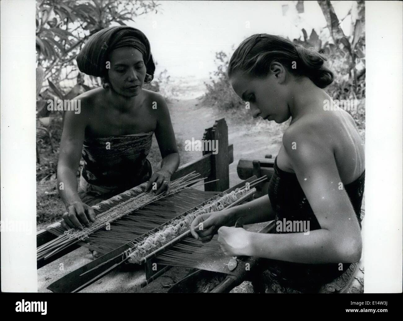 Apr. 18, 2012 - Weaving silk cloth is one of the handicrafts for which the island of Bali is famous. - Stock Image