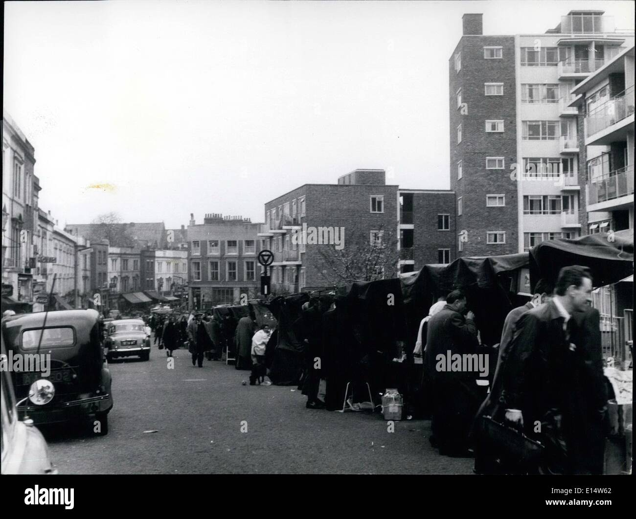 Apr. 18, 2012 - Long view of the Portobello Rd with covered stalls on the right shops to the left and new flats towering above all. - Stock Image