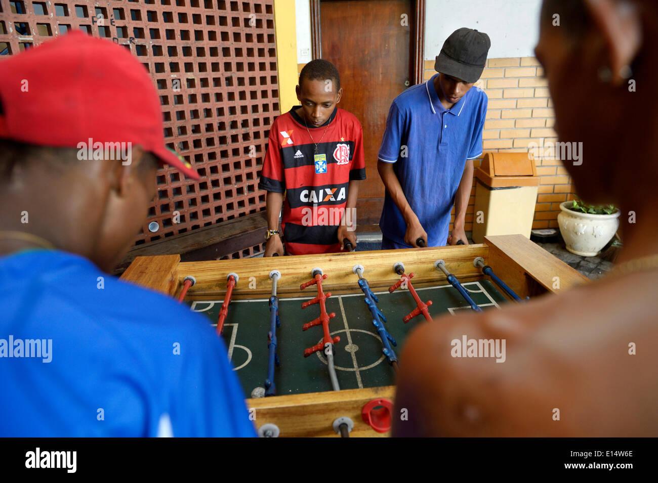 Boys playing table football, Sao Martinho social project for street children, Lapa district, Rio de Janeiro - Stock Image