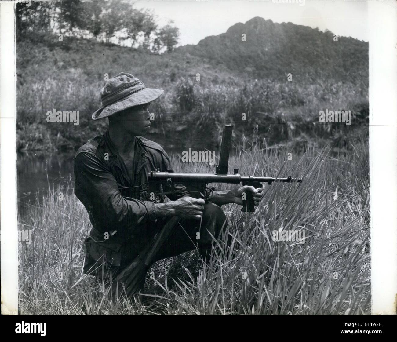 Apr. 18, 2012 - AN IBAN RANGER WITH THE NEW ZEALANDERS IN MALAYA: Trackers for the N.Zealanders in Malayan anti-terrorist patrols are the men from Sarawak, known as Iban Rangers. They are born hunters and trackers, and good shots with modern automatic weapons. - Stock Image