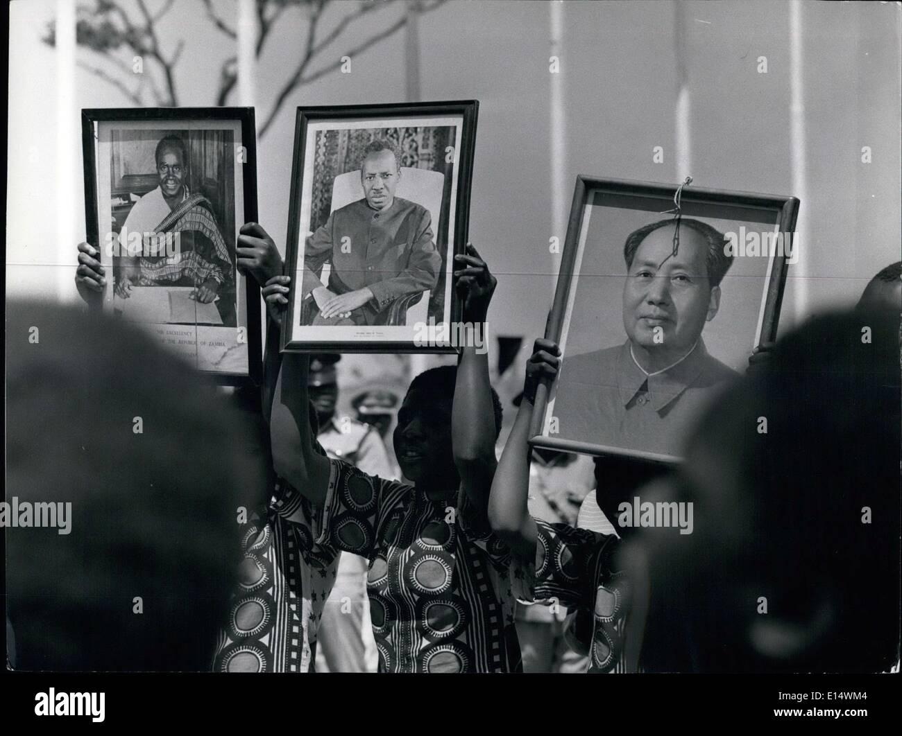 Apr. 18, 2012 - Dancing children hold aloft portraits of Chairman Mac Tsu-tund together with those of Presidents Nyerere and Kauna. Border crossing emergency for UHURU railroad at Zanbia-Tanzania border. - Stock Image