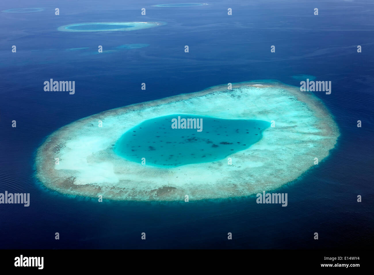 Aerial view, sunken island and coral reef, Indian Ocean, Maldives - Stock Image