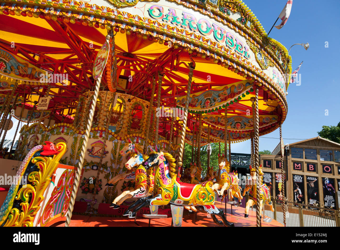 Unoccupied traditional carousel fair ground ride. - Stock Image