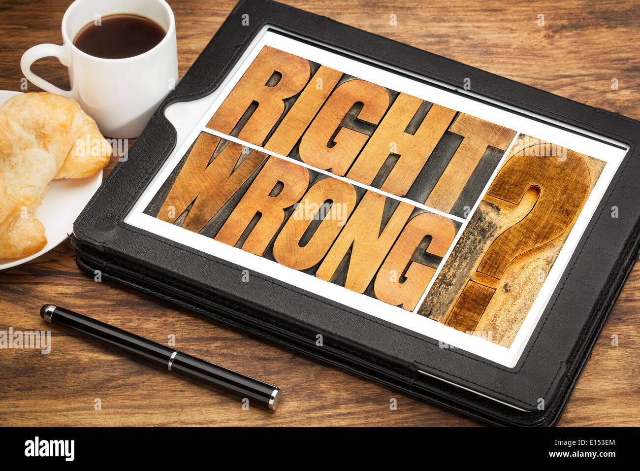 right or wrong ethical choice dilemma - word abstract in wood letterpress printing blocks on a digital tablet Stock Photo
