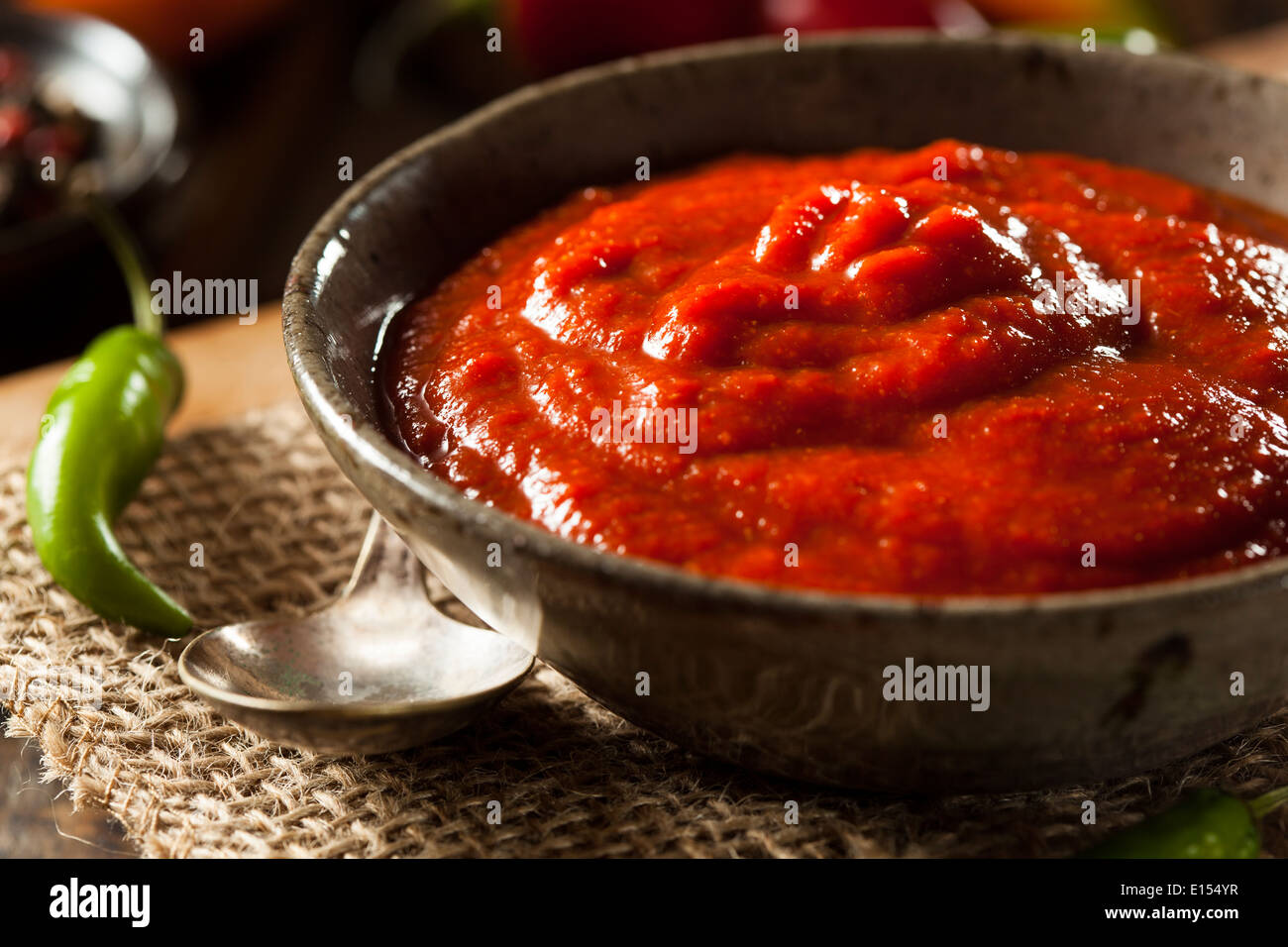 Hot Spicy Red Sriracha Sauce in a Bowl - Stock Image