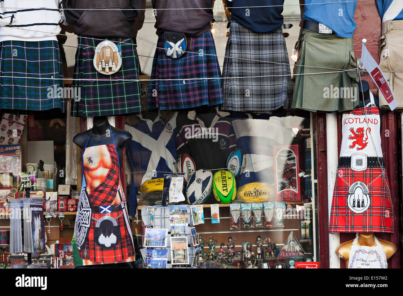Kilts and tartan outside a Scottish souvenir shop on the Royal Mile, Edinburgh - Stock Image