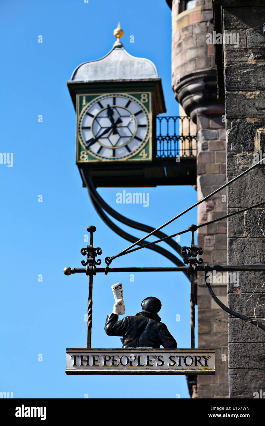 The Tolbooth Clock and sign for The People's Story Museum on the Royal Mile, Edinburgh - Stock Image