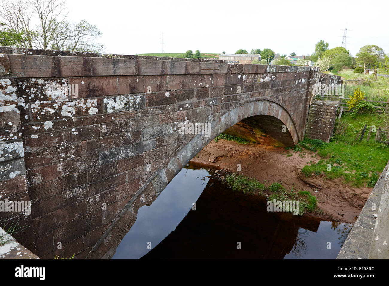 plump bridge over the river sark which forms the scotland england border between dumfries and galloway and cumbria at gretna - Stock Image