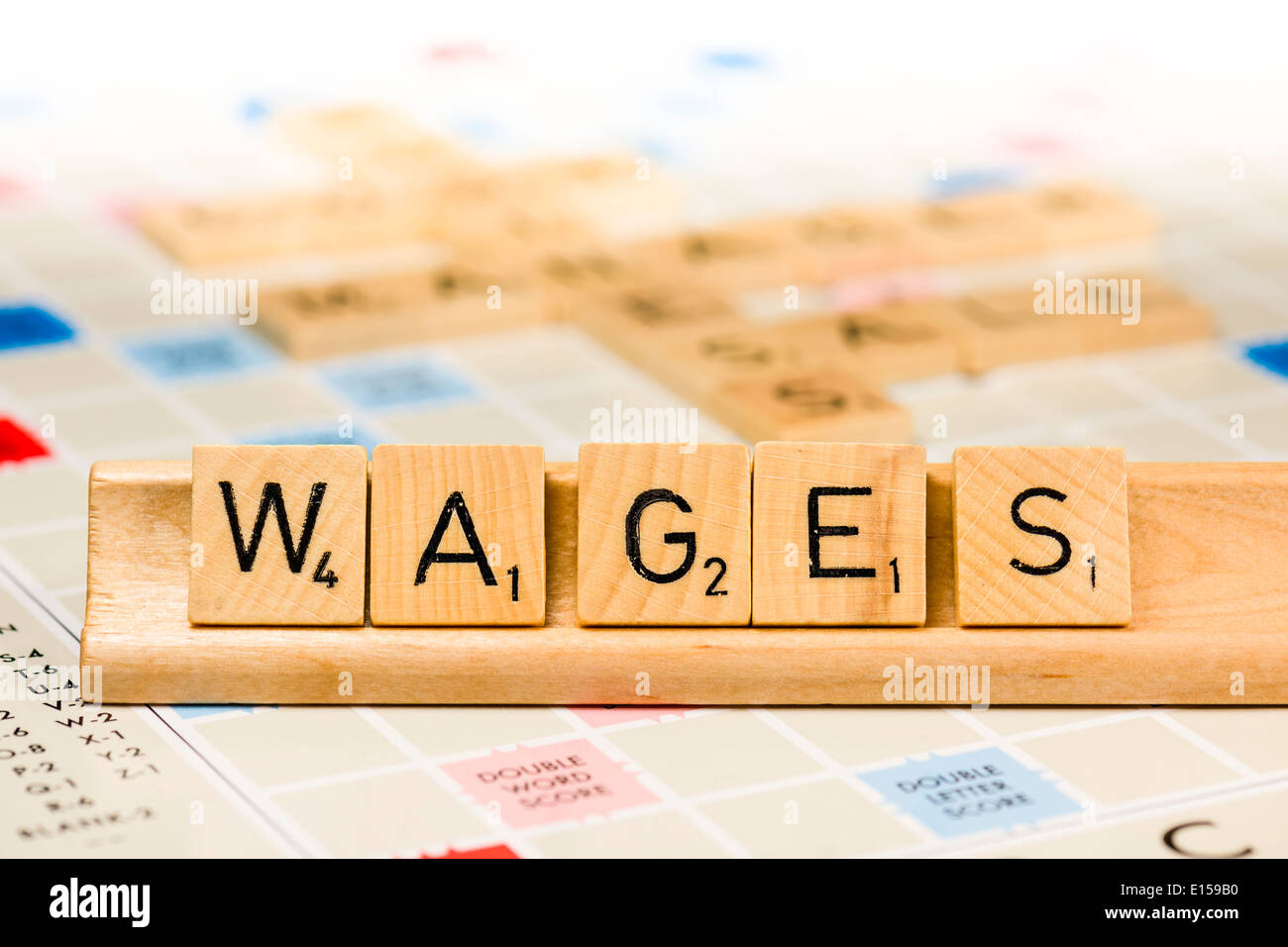 Scrabble - Wages - Stock Image