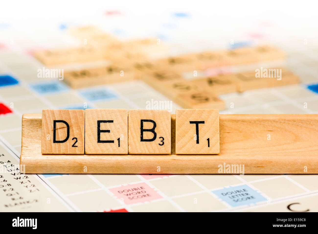 Scrabble - Debt - Stock Image