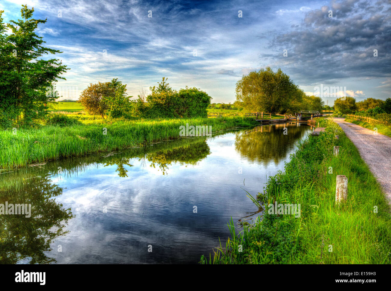 English countryside scene with canal and lock gates in colourful bright and vivid HDR Stock Photo