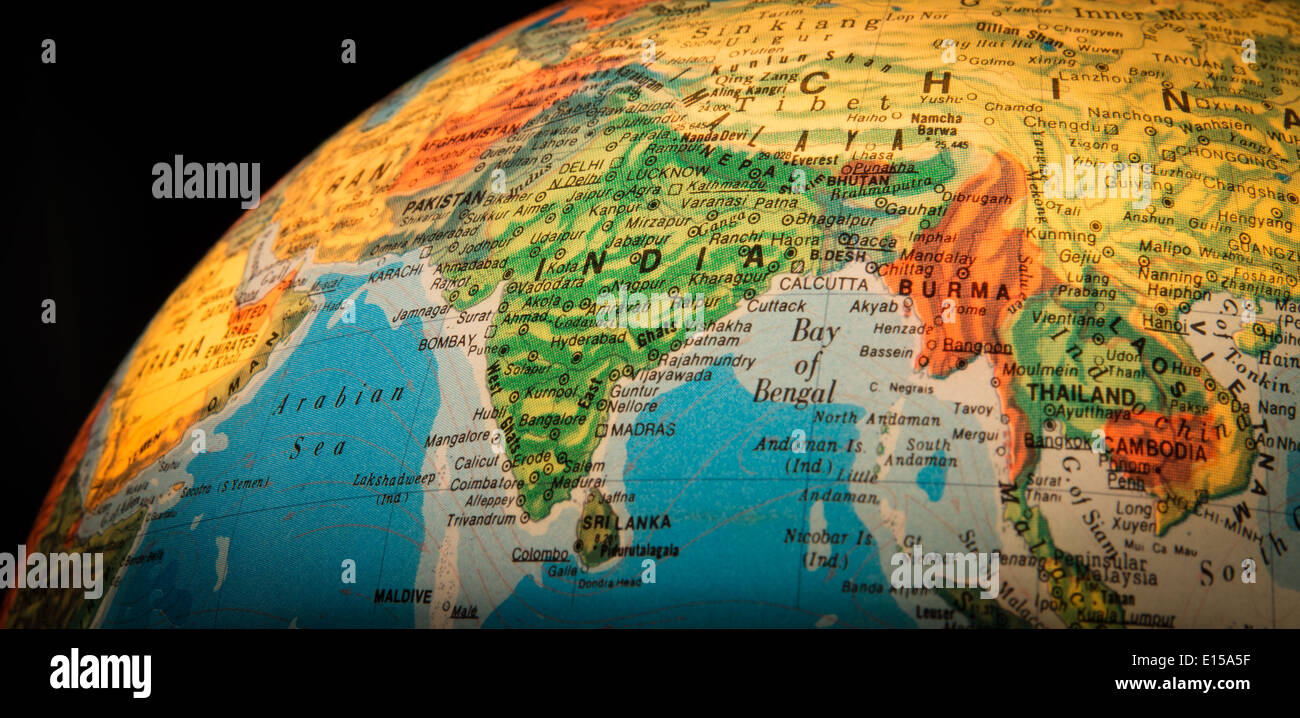 India highlighted on a globe against a black background. Stock Photo