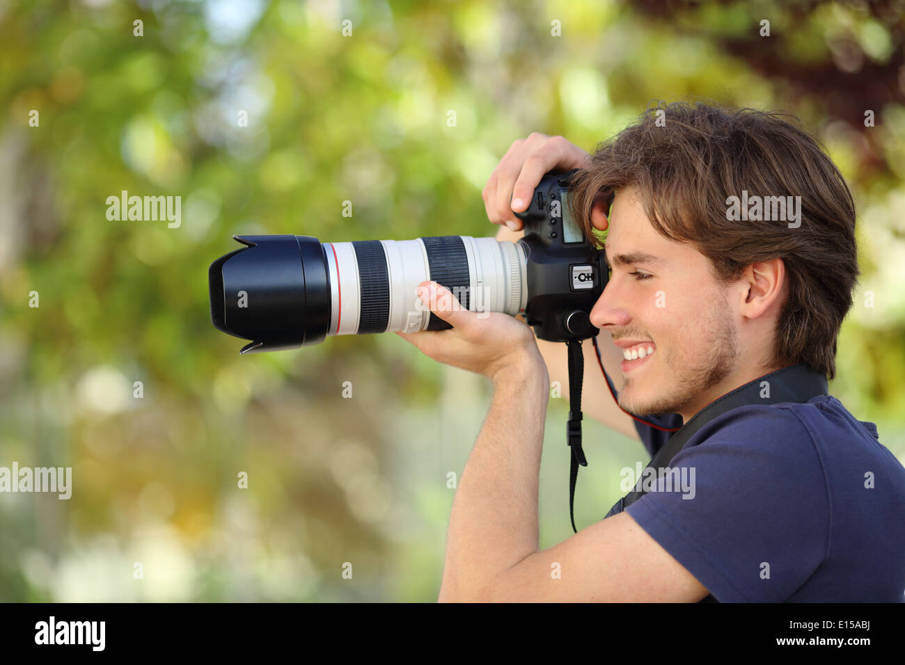 Photographer Taking A Photograph Outdoor With A Dslr Camera With A Stock Photo Alamy