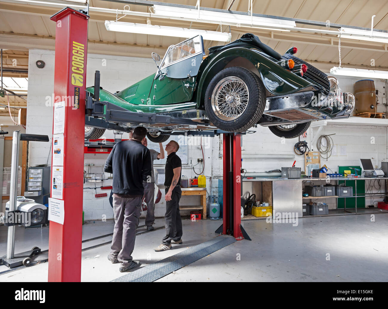 Final inspection of a finished Morgan car on a car ramp at the Morgan Motors Car factory - Stock Image
