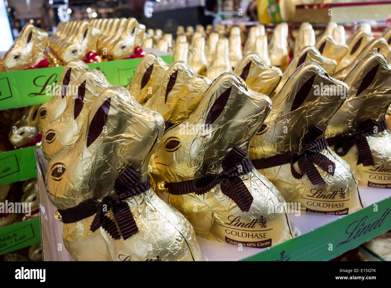 Lindt chocolate Easter rabbit pallet in a store - Stock Image