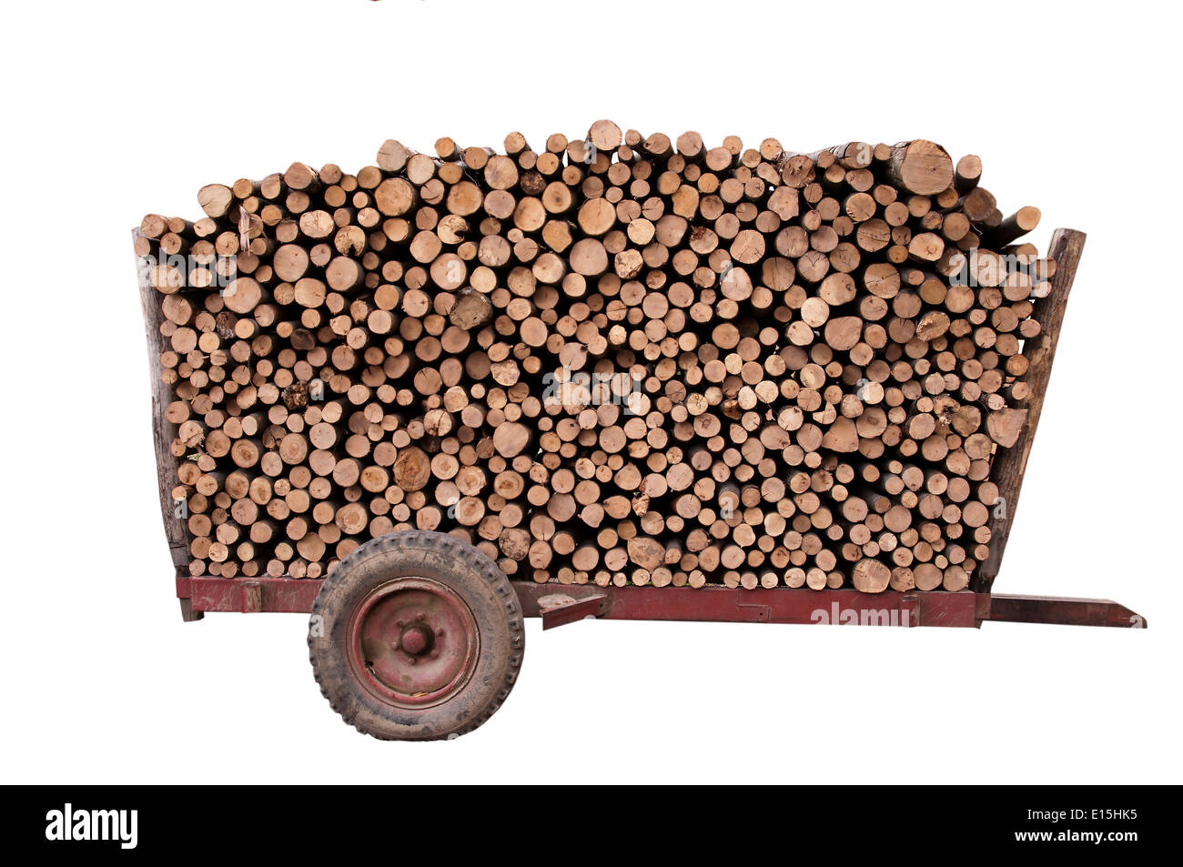 firewood on a trailer, isolated on white background - Stock Image