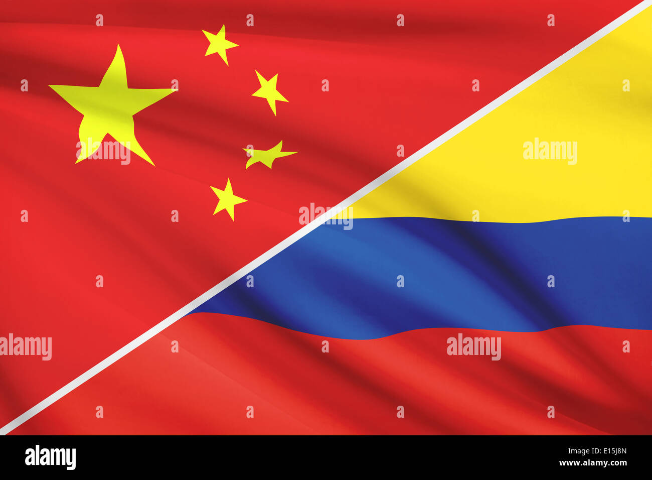 Flags of China and Republic of Colombia blowing in the wind. Part of a series. - Stock Image