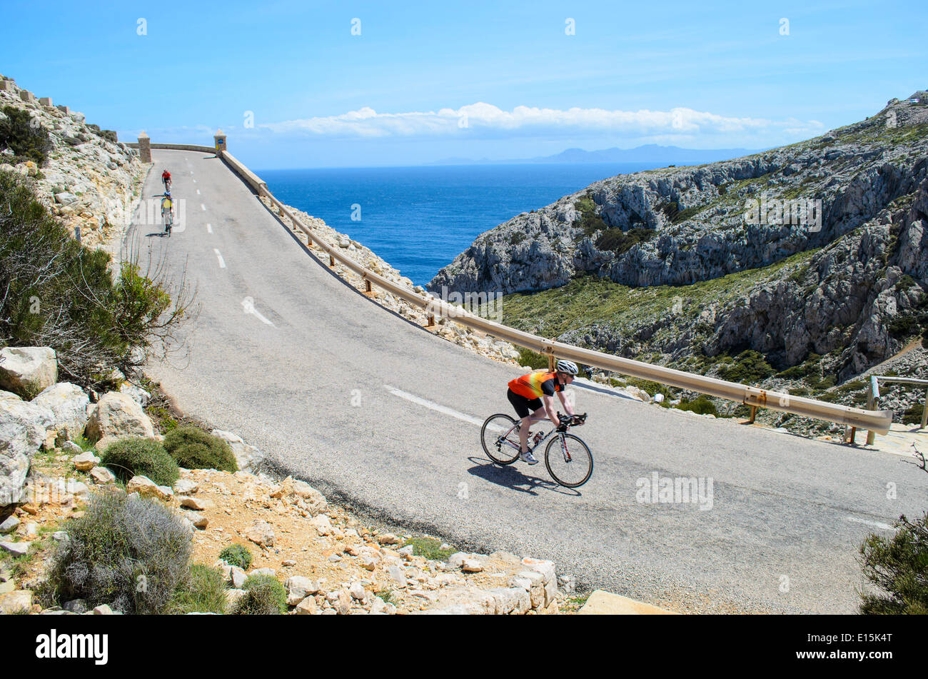 Riding bicycles on Mallorca road - Stock Image